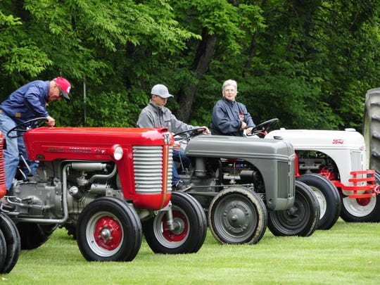 Jarold Hawks, Kyle Blashill and Linda Fey park their tractors at the Lexington A&W Antique Tractor Show on Saturday, June 16, 2018.