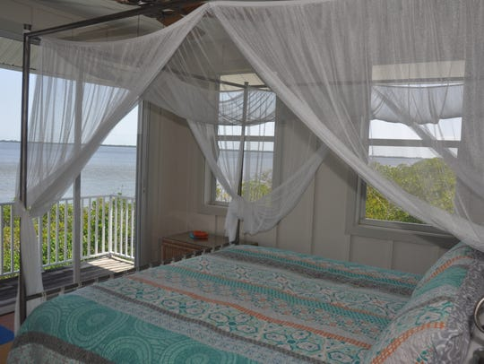 The master bedroom has a canopy bed that faces the