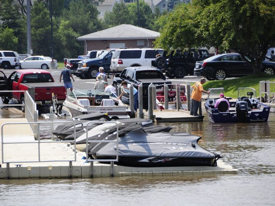 Boaters wait to launch and to leave the water at the