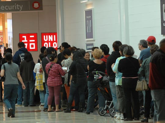 Crowds lined up outside the Uniqlo store at Westfield Garden State Plaza on opening day, September 28, 2012.