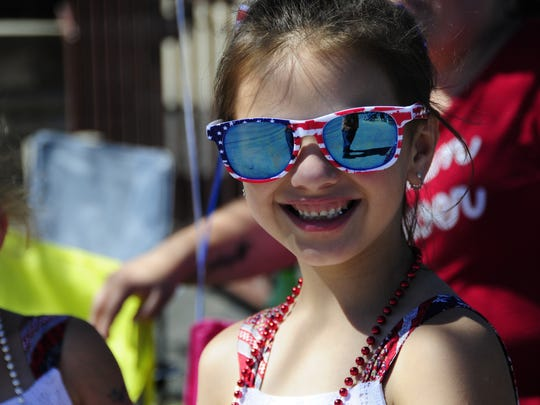 Julianna Mirling, 10, of Port Huron waits for the start of the Independence Day Parade in Lexington on Saturday, July 7, 2018.