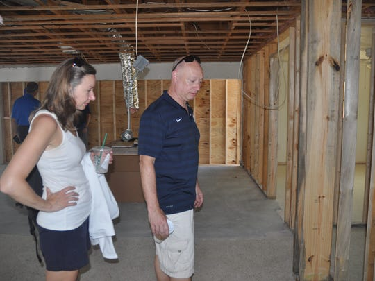 Bob and Krystyna Lack look at the progress in their home.