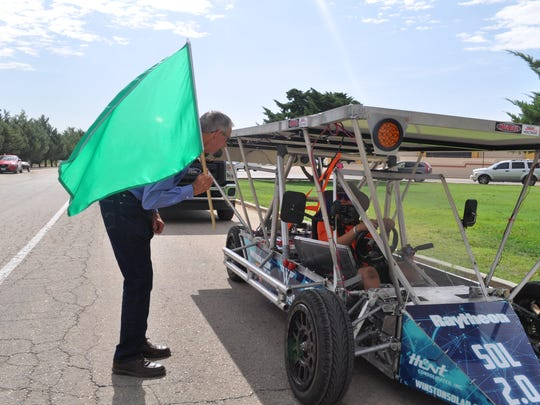 Carlsbad Mayor Dale Janway wishes the pilot of a solar car in the 2018 Solar Car Challenge luck before launch July 18. The participants left the Walter Gerrells Center headed toward El Paso.