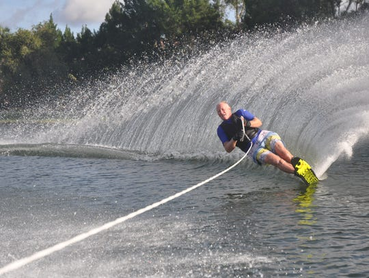 Floyd Rodgers water skis on the lake in The Harborage