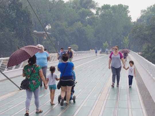 Smoky skies over Redding didn't stop visitors from enjoying the Sundial Bridge on Sunday.