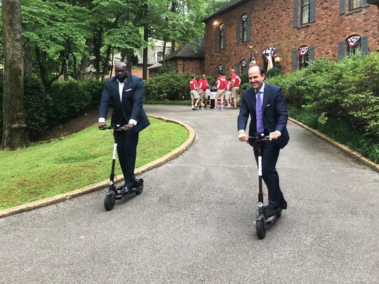 Memphis City Council chairman Berlin Boyd (left) and council member Kemp Conrad test ride a couple of Bird scooters, which are set to roll out in Memphis as soon as Friday.