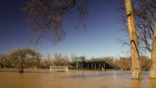 Soccer goals are under water at DeMartin Soccer Complex Friday, April 7, 2017 at Michigan State University.  Water levels are expected to raise at least a foot over night.