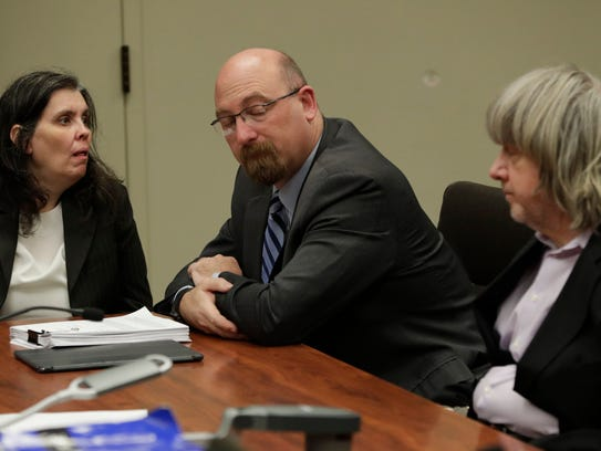 Louise Turpin, left, lawyer Jeff Moore, and David Turpin