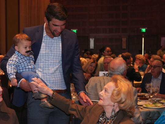 Michael Phelps and son Boomer talk with Barbara Sinatra