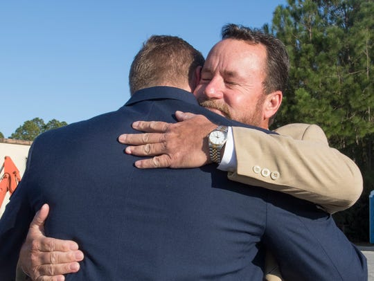 Steve Lewis hugs his son Staff Sgt. Christopher Lewis