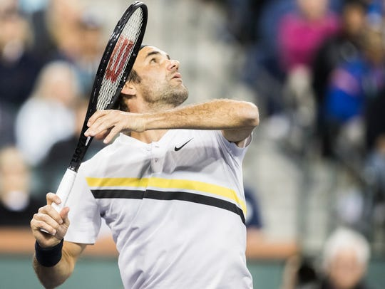 Roger Federer of Switzerland plays against Hyeon Chung