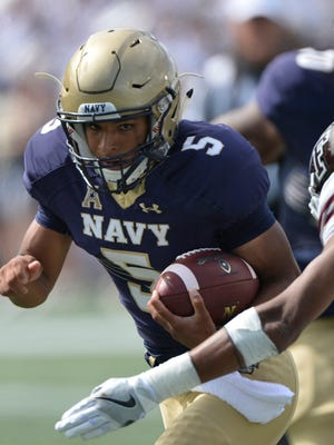 Navy Midshipmen quarterback Malcolm Perry (5) runs during the during the second half against the Fordham Rams at Navy Marine Corps Memorial Stadium.