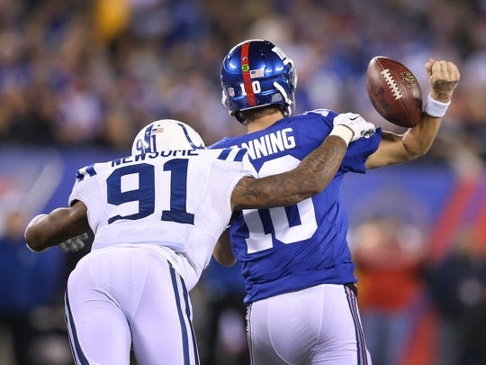 Indianapolis Colts Jonathan Newsome strips New York Giants QB Eli Manning in the third quarter. Indianapolis traveled to New York for Monday Night Football on November 3, 2014.