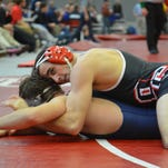 Olivet College's Rodney Harvey (top) went 3-0 at the Comet Duals on Nov. 21.