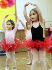 Augustyen (right), 4,  and  Sofia Melvin, 4, practice