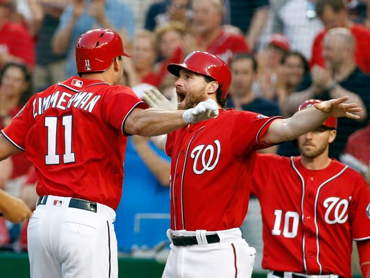 Washington Nationals' Ryan Zimmerman celebrates his two-run home run with Daniel Murphy, center, during the second inning of a baseball game against the St. Louis Cardinals, Saturday, May 28, 2016, in Washington. (AP Photo/Alex Brandon)