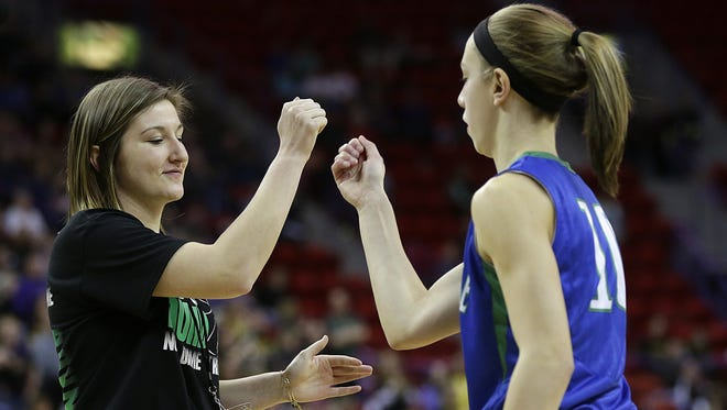 Green Bay Notre Dame senior Maddie Halama and Olivia Campbell during introductions before Friday's WIAA Division 2 girls state basketball game against New Berlin Eisenhower at the Resch Center in Ashwaubenon.