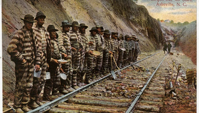 "In 1855, the North Carolina legislature issued a charter to the Western North Carolina Railroad to begin laying track from Salisbury to ""beyond the Blue Ridge."" The outbreak of the Civil War delayed construction, and it wasn't until 1869 that track was laid into Old Fort. The steep grade and corruption among those granted money to complete the line delayed the continuation of track into Asheville.  Finally, in 1875 in an effort to cut costs, the railroad corporation began leasing convicts, a few of whom are pictured in this historic postcard from the Swannanoa Valley Museum & History Center's extensive archive. The convicts were primarily African Americans imprisoned for petty crimes, who were forced to  perform the brutal work required to cut embankments, culverts, arches and tunnels into the mountain. Because the railroad could simply lease another convict if one died while working, there was little incentive to keep the men healthy, and during the course of construction 125 workers died in tunnel cave-ins and other accidents. In 2016, the incredible story of North Carolina's quest to lay track up the steep grade from Old Fort to Asheville will be featured in the Swannanoa Valley Museum & History Center's fifth annual Historic Haunted House Tours on Friday, Oct. 28 and Saturday, Oct. 29. During the tour, visitors will encounter a few costumed ""convicts"" during a brief rest at one of their two daily meals."