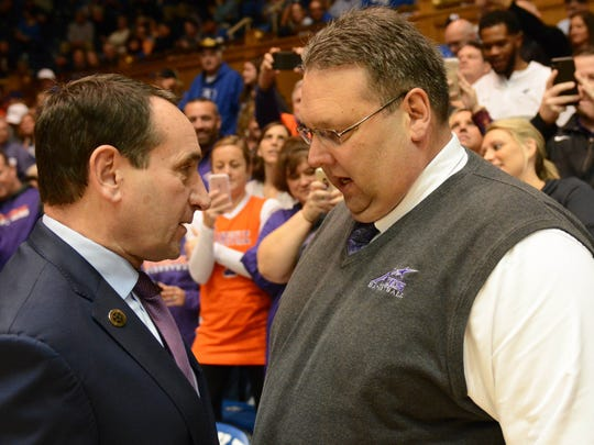 Dec 20, 2017; Durham, NC, USA; Duke Blue Devils head coach Mike Krzyzewski (left) talks to Evansville Purple Aces head coach Marty Simmons prior to a game at Cameron Indoor Stadium. Mandatory Credit: Rob Kinnan-USA TODAY Sports