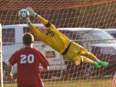 Arlington's Ryan Wilson deflects a shot on goal during Tuesday's game versus Ketcham in LaGrangeville.