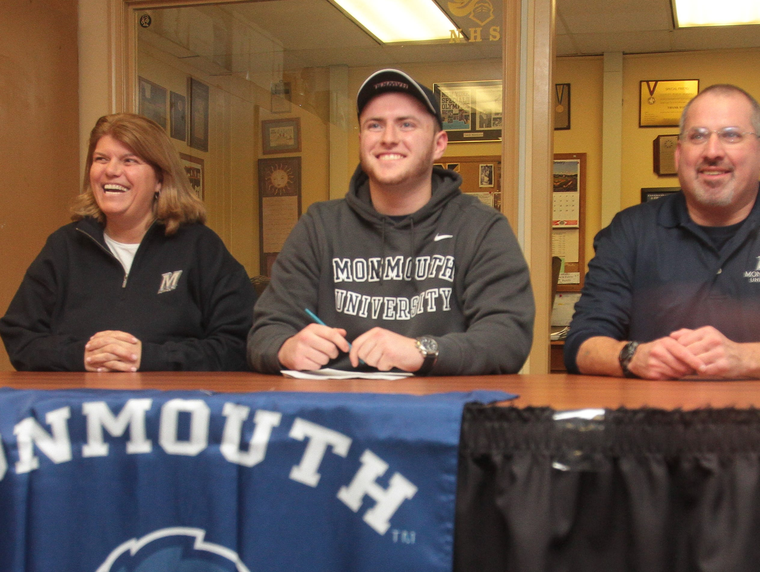 Brian Syracuse (center) with his parents Gloria (left) and Bob (right) on National Signing Day Feb. 3, 2016 at Nanuet Senior High School