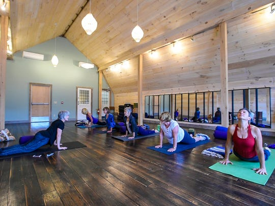 Christy Evans leads a yin yoga class at the ZenBarn