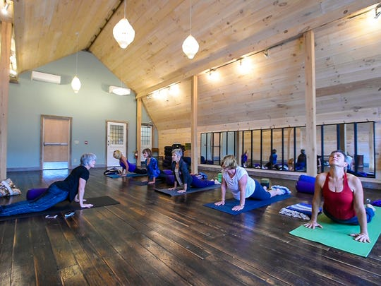 Christy Evans leads a yin yoga class at the ZenBarn in Waterbury on Monday, October 30, 2017.