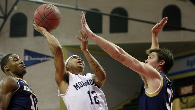 Monmouth's Justin Robinson scored 22 points in an upset of No. 17 Notre Dame.