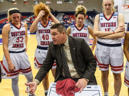 USI Head Coach Rick Stein talks to his team during a time out in the fourth quarter against the Ohio Dominican Panthers at USI's Phyiscal Activities Center in Evansville, Ind., Thursday, Nov. 16, 2017. The Screaming Eagles defeated the Panthers, 77-50.