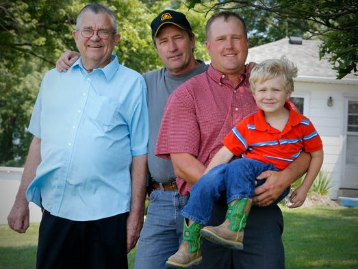 Four generations of Dammanns on their Page County farm northwest of Clarinda.  From left are Arnold, 79; Danny, 57; Justin, 34; and Jayden, 3.