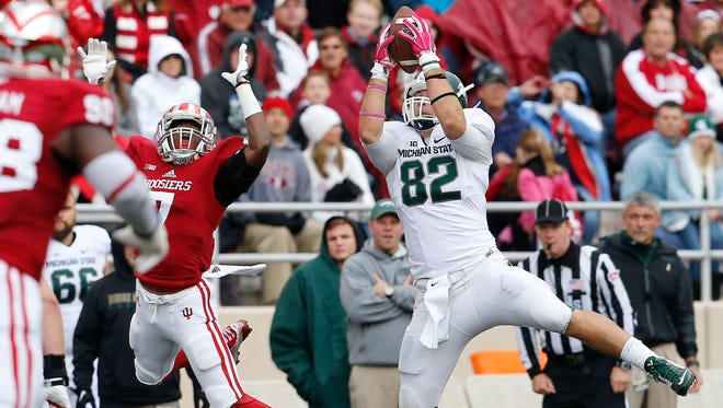 Michigan State tight end Josiah Price (82) hauls in a pass against Indiana on Oct. 18, 2014.