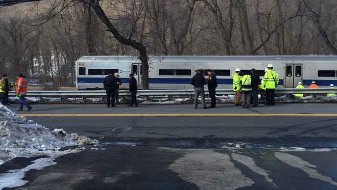 Emergency responders on the scene after a Harlem Line derailed north of the Hawthorne station when a railcar struck a tree, Monday, Feb. 13, 2017.
