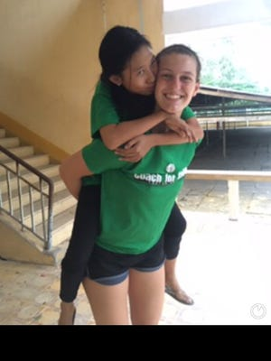Clyde's Amanda Cahill, right, spent three weeks teaching and coaching in Vietnam last month.