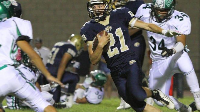 Desert Hot Springs quarterback Andrew Moreno runs the ball during the first half of the game against Banning High School in Desert Hot Springs Friday. Desert Hot Springs won in overtime 20-14.