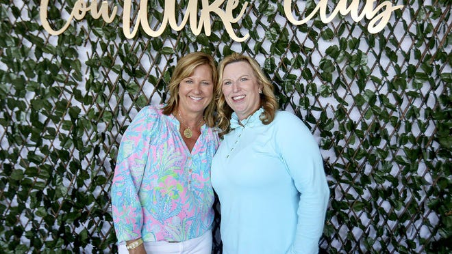 CoTOURe Club founder Kelly Kennerly, left, and its director, Deborah Jaffe, pose for a photo Saturday, Feb. 29, 2020, inside the club's hospitality venue at the Honda Classic. The 125-member club provides personalized service to the tournament's sponsors and spectators, and raises awareness of the charitable contributions made by the Honda Classic.
