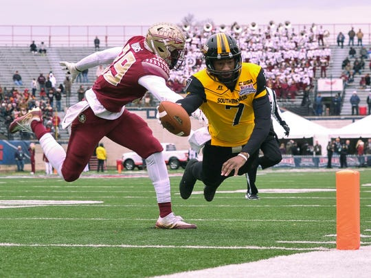 Southern Miss quarterback Kwadra Griggs (7) dives into the end zone against Florida State Seminoles defensive end Brian Burns (99) during the first half in the 2017 Independence Bowl at Independence Stadium.