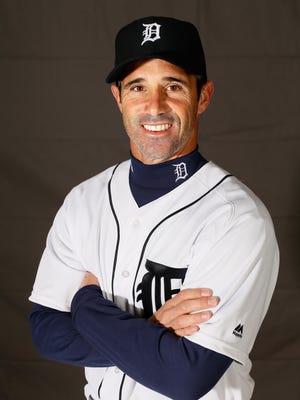 """Tigers manager Brad Ausmus gets his picture taken on """"Photo Day"""" during spring training at Joker Marchant Stadium in Lakeland, Fla. on Saturday, Feb. 27, 2016."""