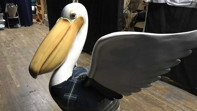 St. John the Evangelist Catholic Church and School recently acquired a special pelican statue in a Navy blue Catholic school uniform.