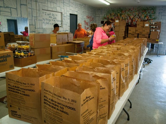 Volunteers at the Salvation Army package food to be distributed to families in Doña Ana County.