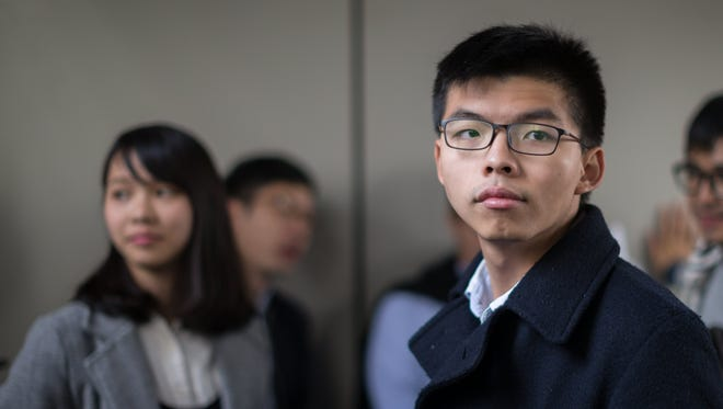 Demosisto party Secretary General Joshua Wong looks on outside the High Court in Hong Kong, China, Jan. 17, 2018. The High Court sentenced Joshua Wong to three months in prison and fellow activist Vice-chairman of the League of Social Democrats Raphael Wong Ho-ming to four months and 15 days jail for contempt of court.