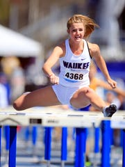Sydney Winger of Waukee runs the girls shuttle hurdle relay at the Drake Relays Saturday, April 28, 2018.