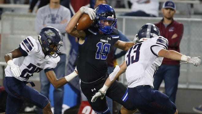 Chandler's Brayden Liebrock (19) carries the ball while being defended by Perry's Darius Holton (26) and Travis Calloway (33) during the 6A high school football state championship game at Arizona Stadium in Tucson on December 1, 2017. #hsfb