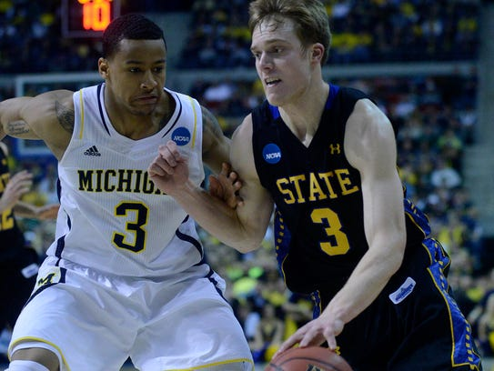 SDSU's Nate Wolters drives past Michigan's Trey Burke