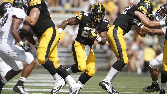 Iowa's LeShun Daniels Jr. runs the ball against Missouri State in 2013.