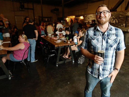 """It's a true social house atmosphere that I don't see anywhere else,"" says Logan Roberts of the scene at the Millennial Brewing Company in downtown Fort Myers. Roberts is the owner/brewmaster at Millennial."