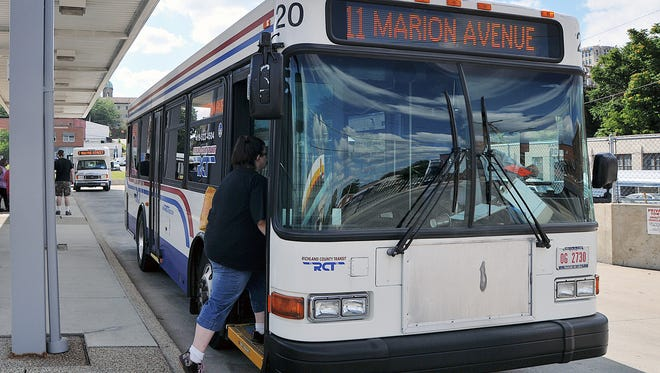 Buses pick up riders at the Stanton Transit Center in downtown Mansfield.