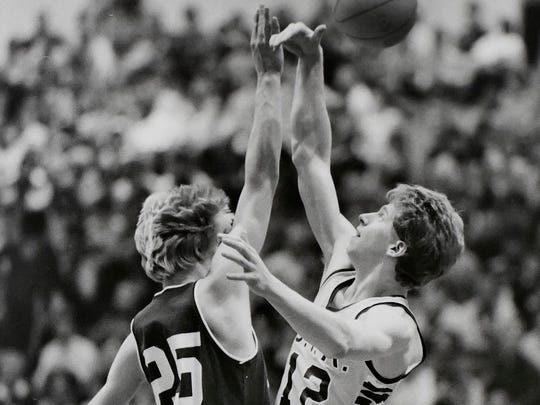 BFA-St. Albans' Brian Kemp, right, leaps for a jump ball against Rice during the 1985 Division I boys basketball championship game.