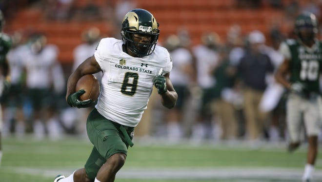 After catching a pass, Colorado State wide receiver Detrich Clark (8) runs in the ball for a touchdown over Hawaii during the first quarter of the NCAA college football game, Saturday, Sept. 30, 2017, in Honolulu. (AP Photo/Marco Garcia)