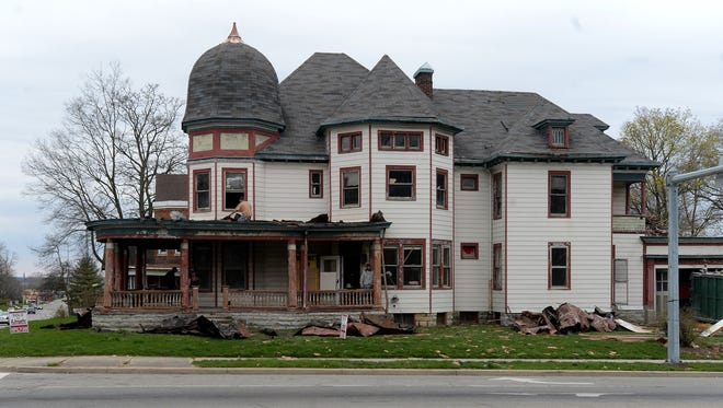 A crew works on the former Crain Sanitarium Wednesday, March 30, 2016 at the corner of North 22nd and East Main streets in Richmond. Ben and Heaven Johnson bought the property through realtor Jamie Clark and immediately got to work clearing it out so it can be renovated.