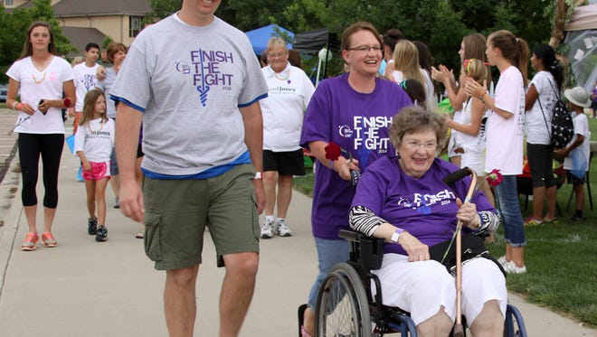 Residents walk laps during the 2014 American Cancer Society Relay for Life in Windsor.